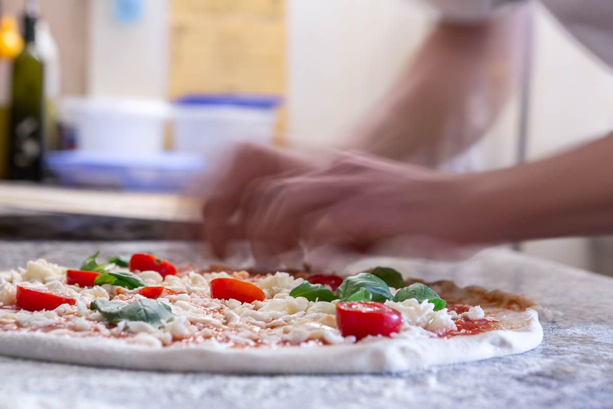 Making of pizza at Licone Pizzeria in Cogne