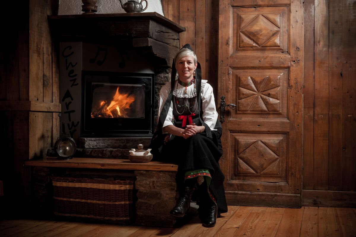 The owner Elisabetta of Lou Ressignon restaurant in Cogne