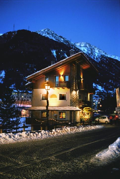 Outside of Lou Ressignon Guest House in Cogne in winter