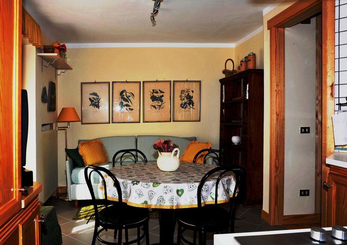 Living area with kitchenette at the apartment Sylvenoire A in Cogne