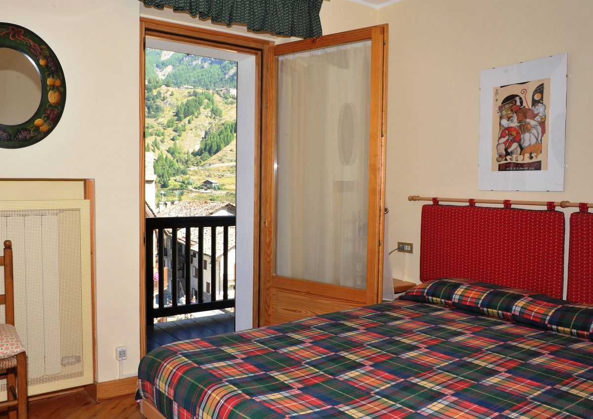 Bedroom in apartment Sylvenoire A in Cogne