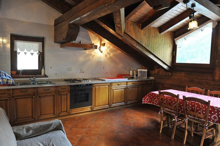 Living area with kitchenette at the apartment Giglio dei Monti in Cretaz