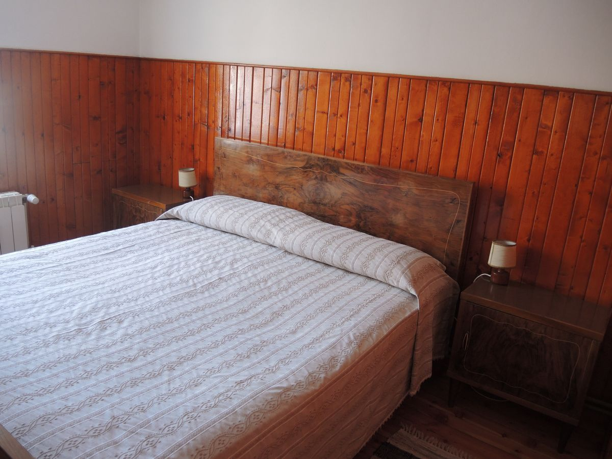 Bedroom of the apartment La Peira in Cogne